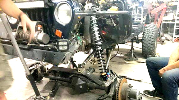 Custom trussed Jeep axle for extreme articulation.