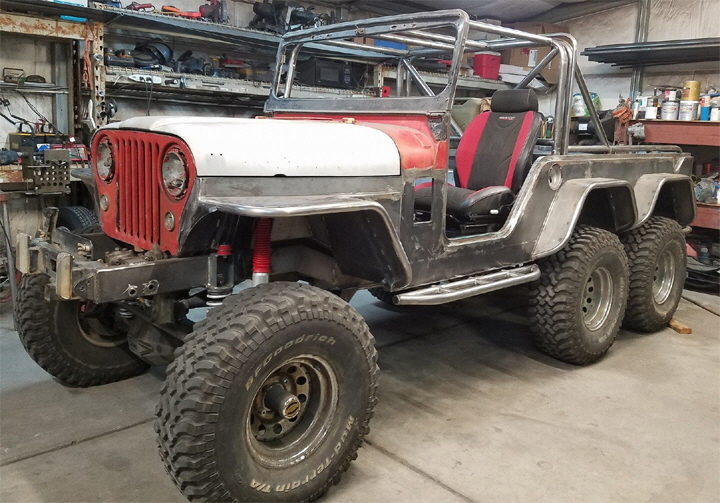 6x6 Jeep complete with custom Roll Cage.